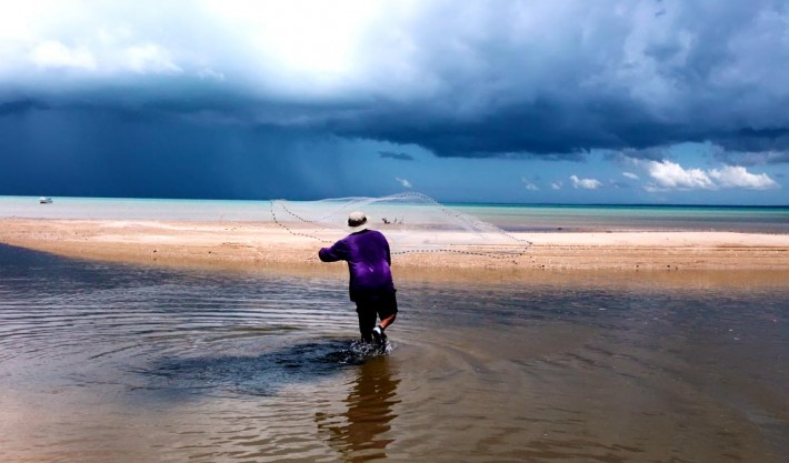 Storm clouds on the horizon while throwing the cast net